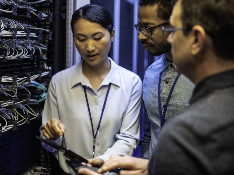 People reviewing data in server room